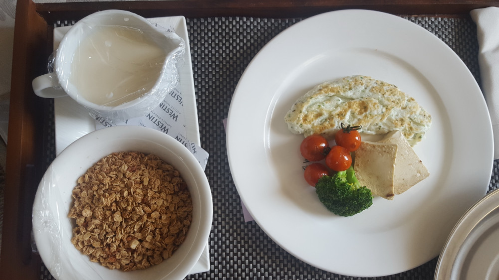 Healthy breakfast at a hotel, with granola & egg white omelet