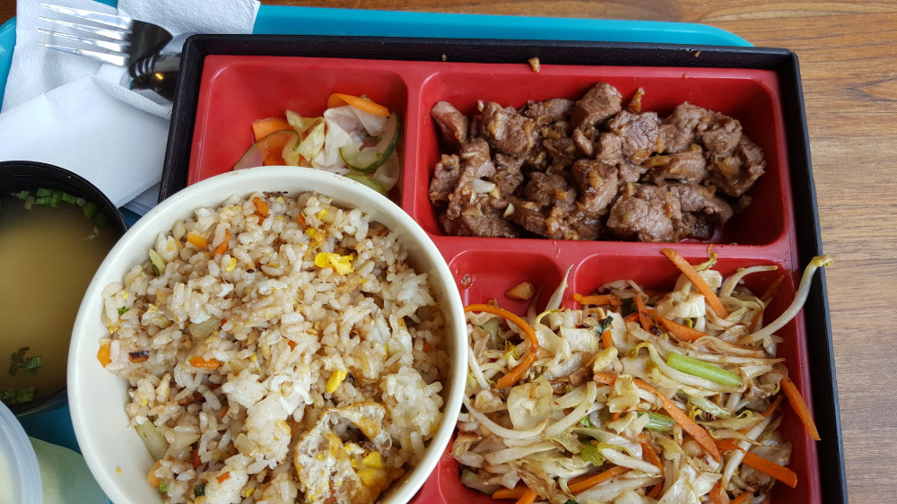 Japanese bento box with teriyaki beef & garlic rice