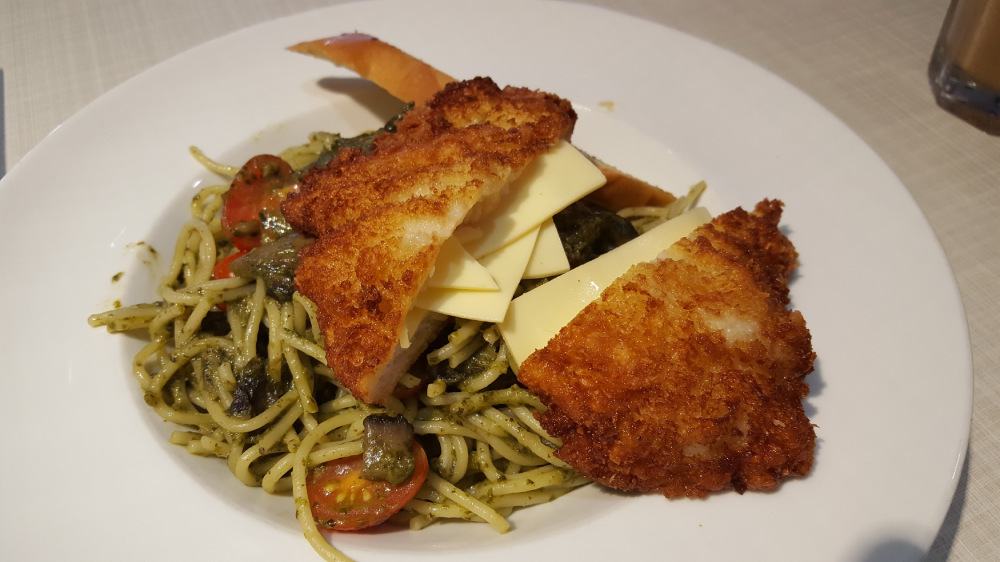 Pesto pasts topped with cheese-stuffed fried fish